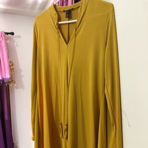 Yellow long sleeve top.